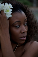 Pretty black woman with a flower in her hair