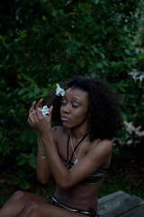 lovely black woman with a flower in her hair