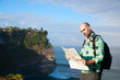 Man tourist with map