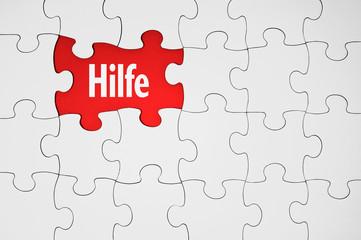 Puzzle mit rotem Hintergrund und Hilfe