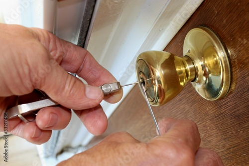 Locksmith Picking a lock