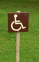 wooden disabled parkign sign