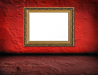 old  elegant golden frame on red plaster rough background and pi