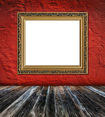 old  elegant golden frame on red plaster rough background and vi
