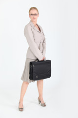 Woman in a skirt suit with a briefcase