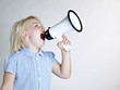 Cute blond girl shouting loud through megaphone