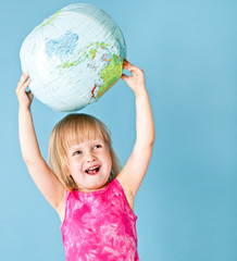 A little girl with a globe