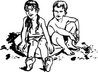 children boy and girl sitting on the beach