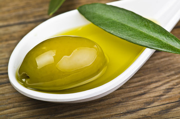 green olives and oil on the spoon ..