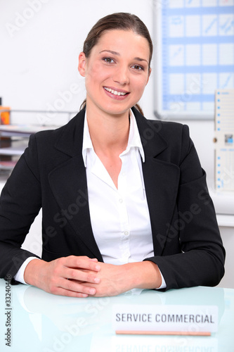 Smiling woman sitting at a desk