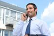 Confident estate agent outside building