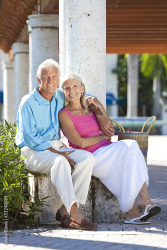 Happy Senior Couple Smiling Outside in Sunshine