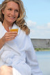 Woman with a glass of orange juice
