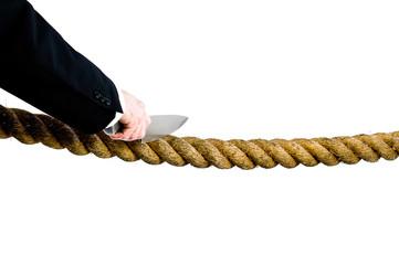 businessman cutting rope