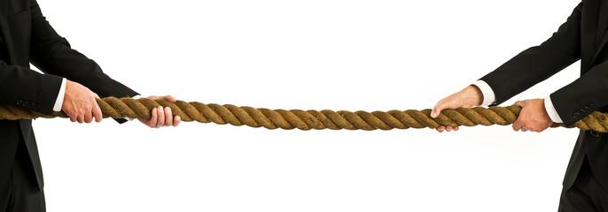 businessmen pulling rope