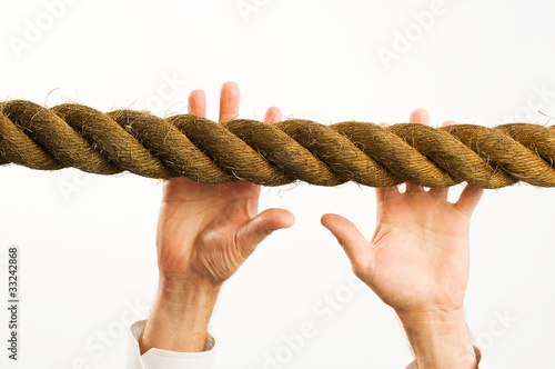 hands reaching to rope