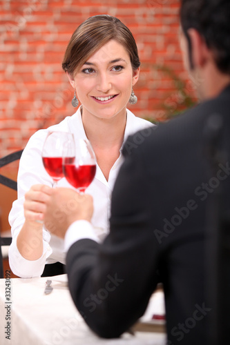 Couple drinking rose wine in a restaurant