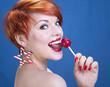 Playful girl with lollipop