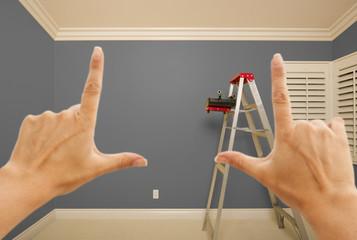 Hands Framing Grey Painted Wall Interior