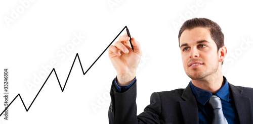 Businessman drawing a rising arrow,  business growth.