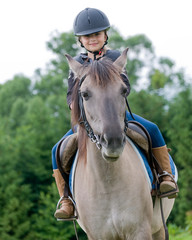 Horse riding - little girl is riding a horse