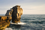 Stunning geological rock cliff formations with waves crashing in poster
