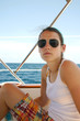 Pretty young woman on sailboat