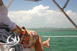 Woman reclining on sailboat in Miami