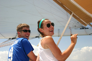 Two friends having fun on a sailboat