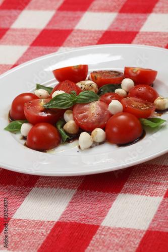 Caprese salad on table cloth