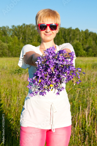 beautiful woman with a flower lilac