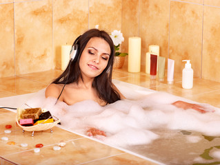 Woman listening to music in bath