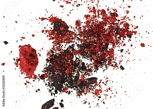 Red and black color crumbled eye shadows isolated on white