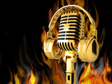 Vintage Microphone on the background of fire