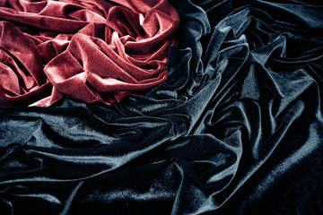 dark red and black glossy velvet is formative folds