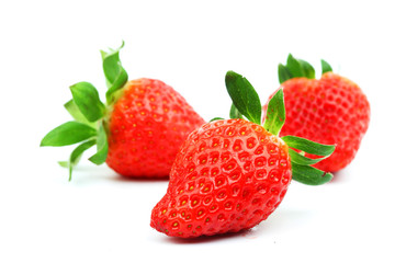 three strawberries isolated