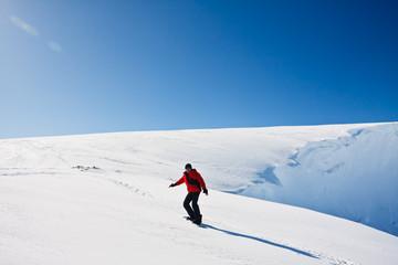 Man moves on snowboard