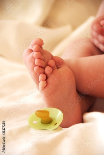 Babyfeet with pacifier