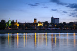 Warsaw durung sundown with reflection in Vistula river - Fine Art prints