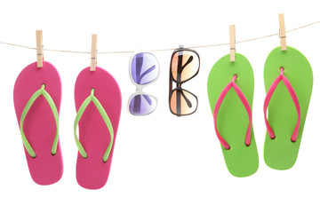 Flip-flop sandles and sunglasses hanging by clips