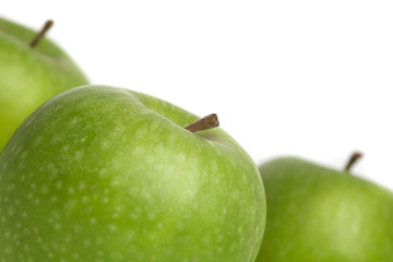 a group of juicy green apples