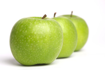 a row of fresh green apples
