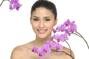 Close up happy young woman with orchid