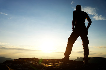 Silhouette of man in mountain.