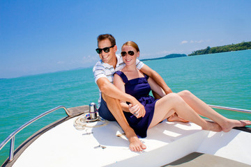 Couple Relaxing On A Boat