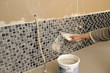 Home improvement - grouting mosaic tiles.