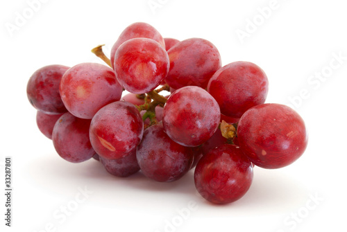 Red grapes isolated on white background