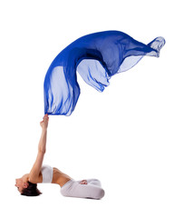 woman in lotos yoga pose with blue flying fabric