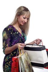 beautiful young girl looking in shopping bags