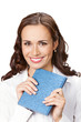 Happy young business woman with notepad, isolated